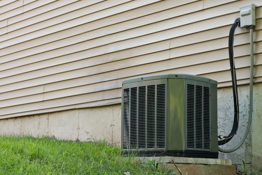 A Residential Central Air Conditioning Unit Sitting Outside A Home Used For Regulating The Homes Ac To A Comfortable Level Ry2cqichj